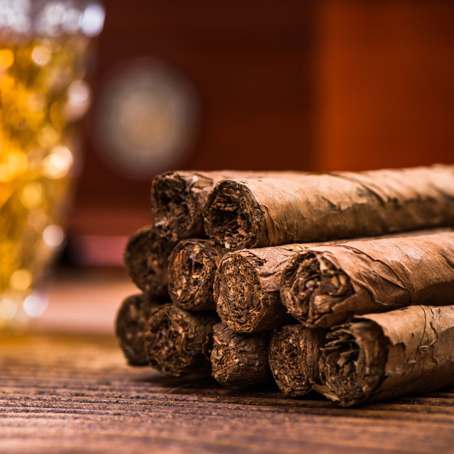 """Cuban cigars on wooden table, close up detail"" stock image"