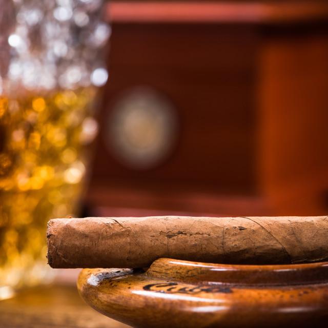 """Cuban cigar on vintage ashtray"" stock image"