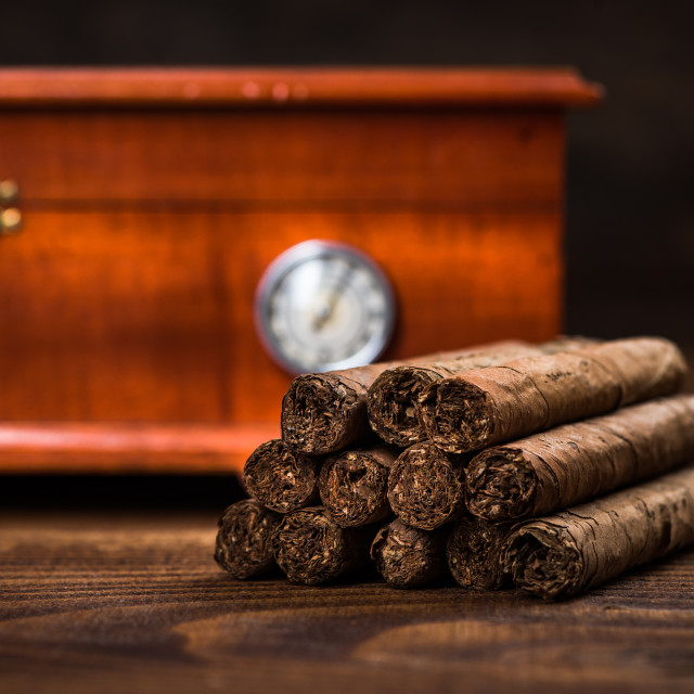"""Cuban cigars with humidor in background"" stock image"