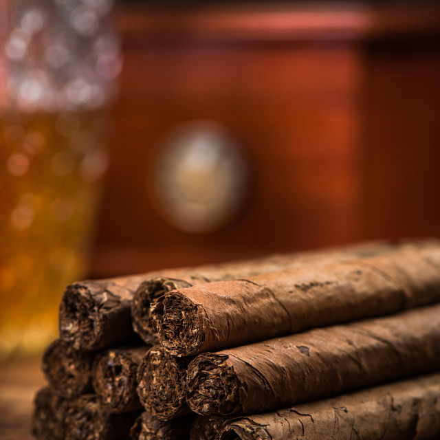 """Close up detail of cuban cigars on table"" stock image"