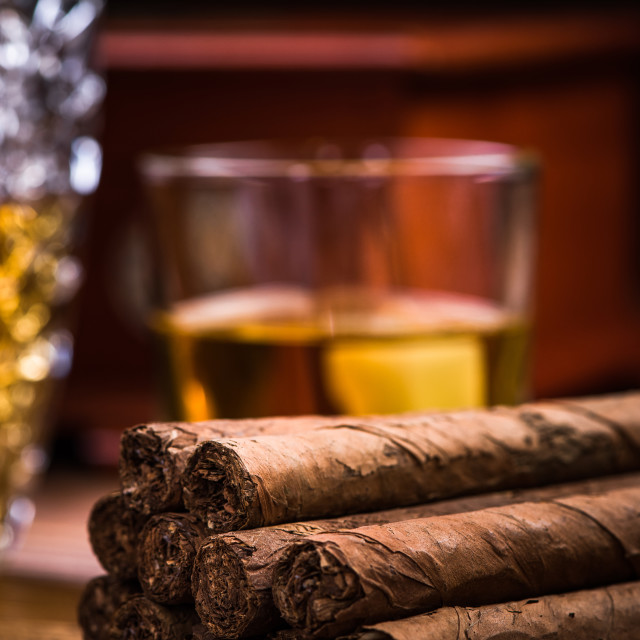 """Cuban cigars on wooden table with humidor and cognac"" stock image"