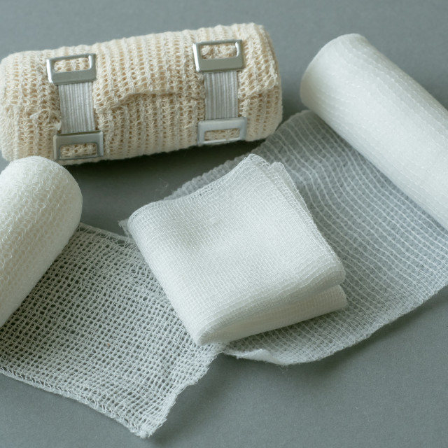 """Medical bandages on gray background. Medical equipment."" stock image"