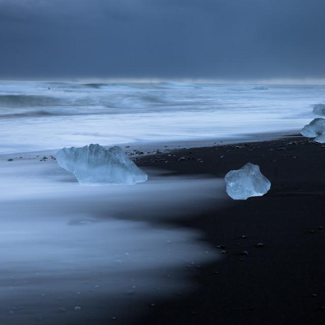 """Black beack with blue Ice"" stock image"