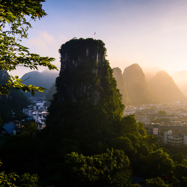 """Sunrise over karst rocks in Yangshuo China"" stock image"