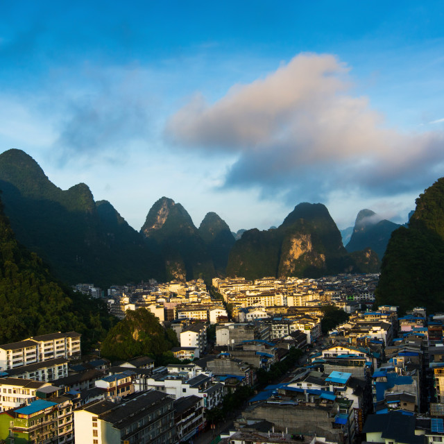"""Cityscape of Yangshuo in China and famous karst formations"" stock image"