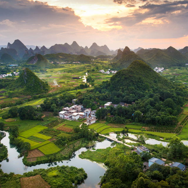 """Stunning sunset over karst formations landscape near Yangshuo Ch"" stock image"