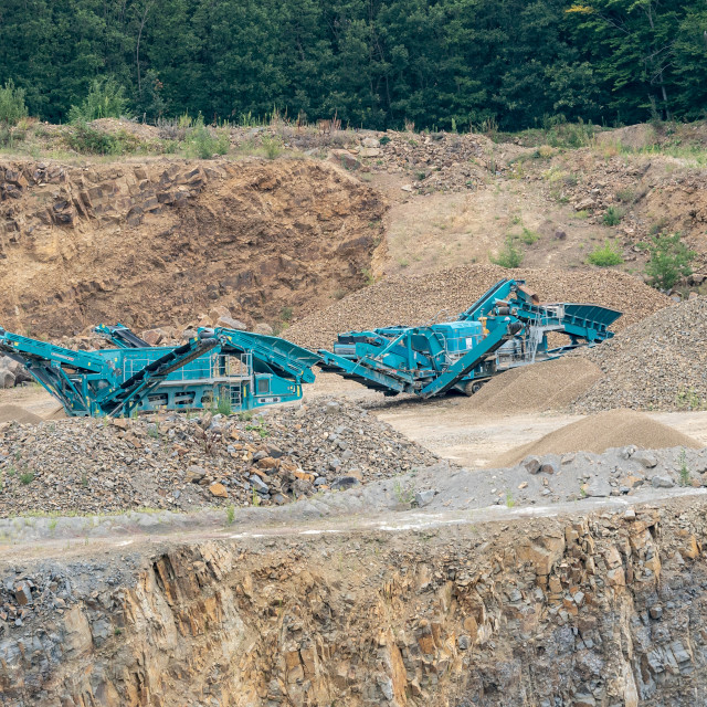 """Stone crusher in the quarry. Working mining machine - stone crus"" stock image"
