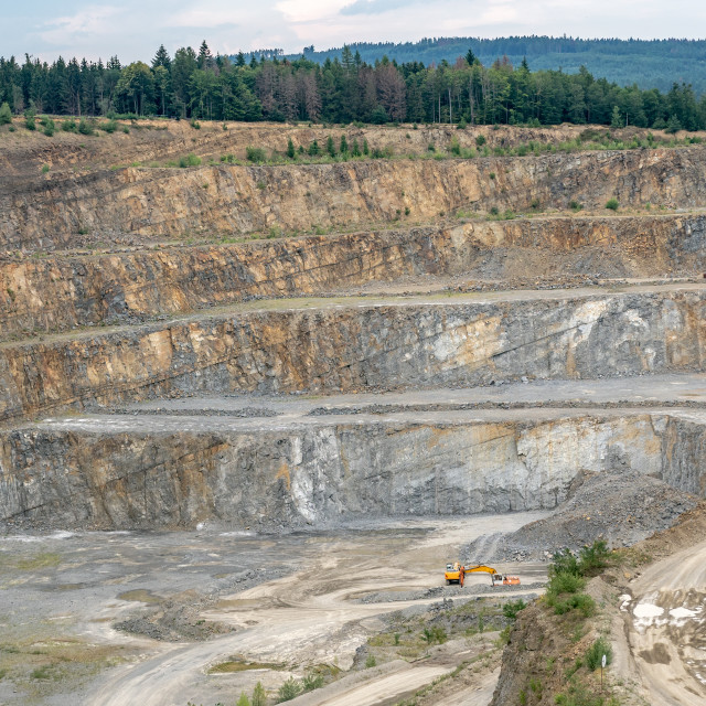 """Opencast mining quarry with machinery. Quarrying of stones for c"" stock image"