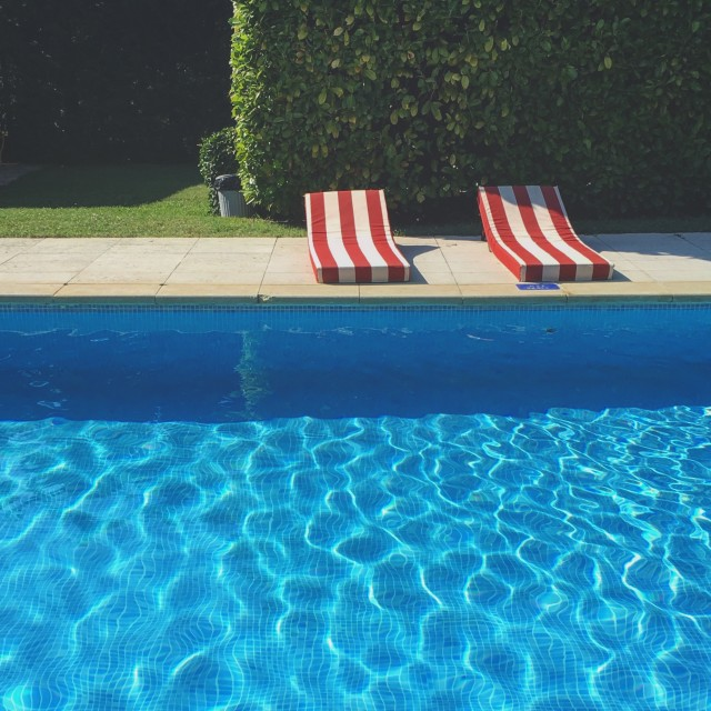"""Pool and pool chairs"" stock image"