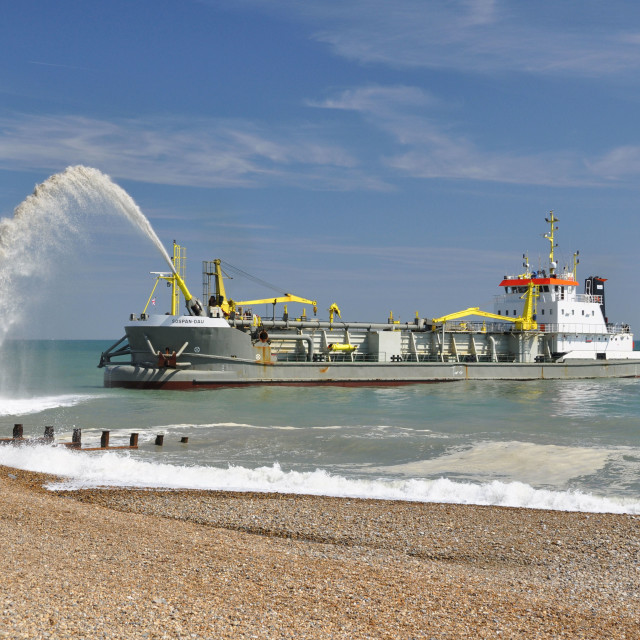"""""""Dredger ads to beach at Eastbourne, East Sussex, UK."""" stock image"""