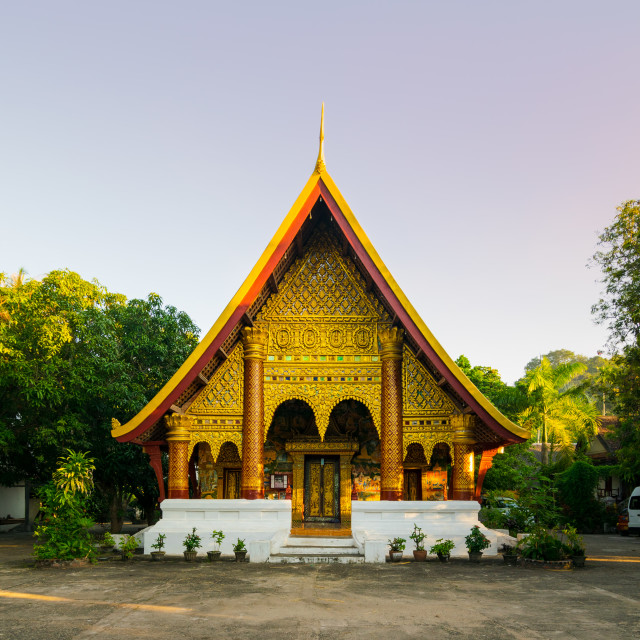 """""""Buddhist temple with golden carved decorations and tiled roof in Vientiane, Laos"""" stock image"""