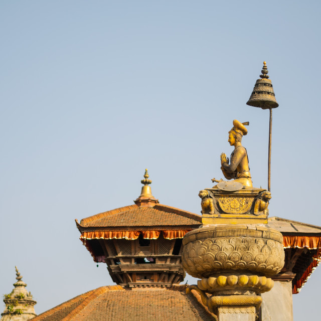"""""""Durbar square in Bakhtapur, Nepal, with temple roofs and votive column with..."""" stock image"""