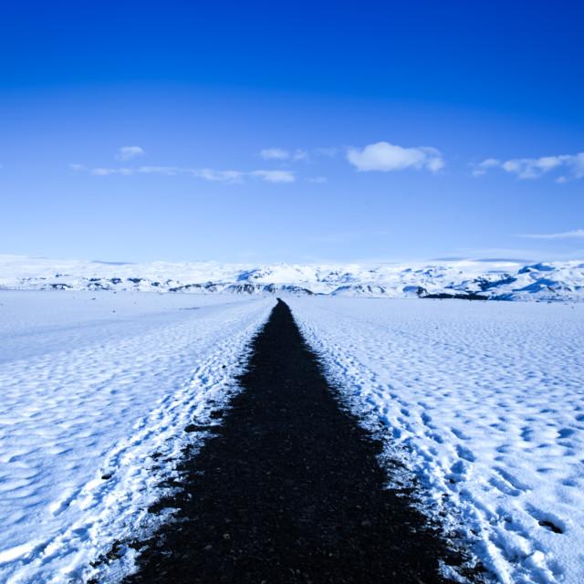 """Straight black path on snow - Iceland"" stock image"
