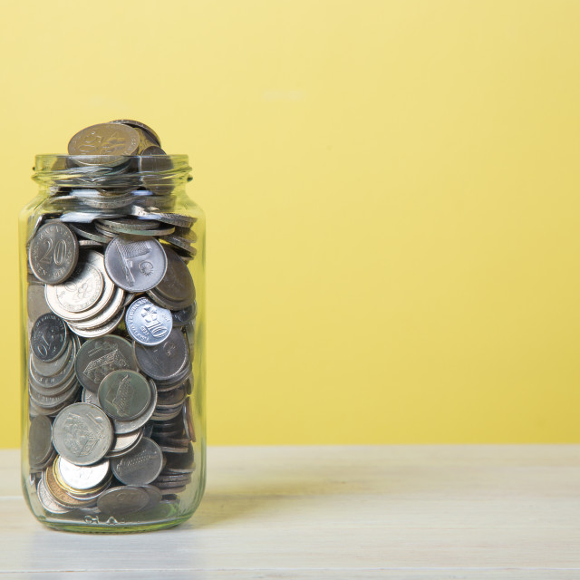 """Jar full of coins."" stock image"