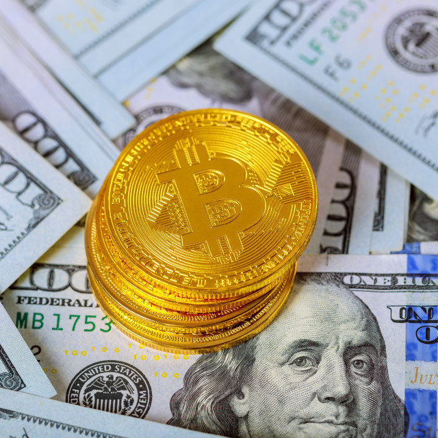 """""""golden bitcoin coin on us dollars close up. Electronic crypto currency"""" stock image"""