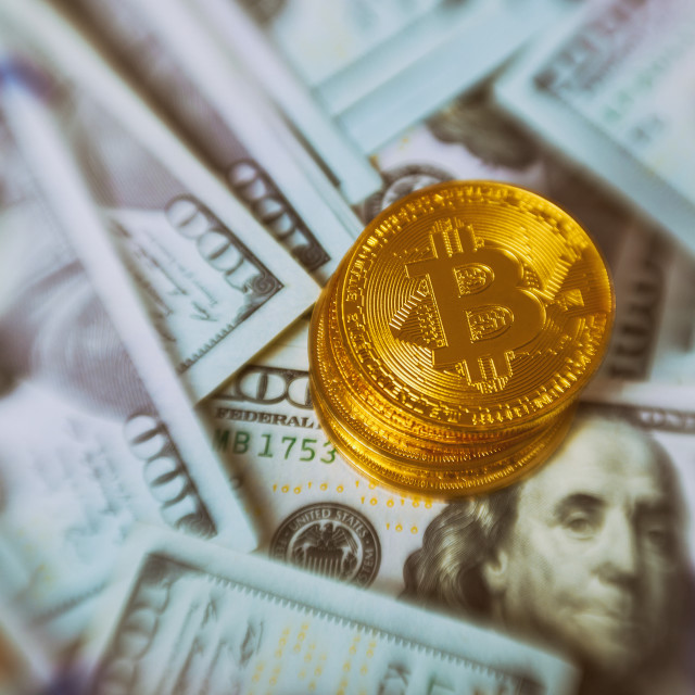 """""""Golden Bitcoins on US dollars for background. Bitcoin digital currency..."""" stock image"""