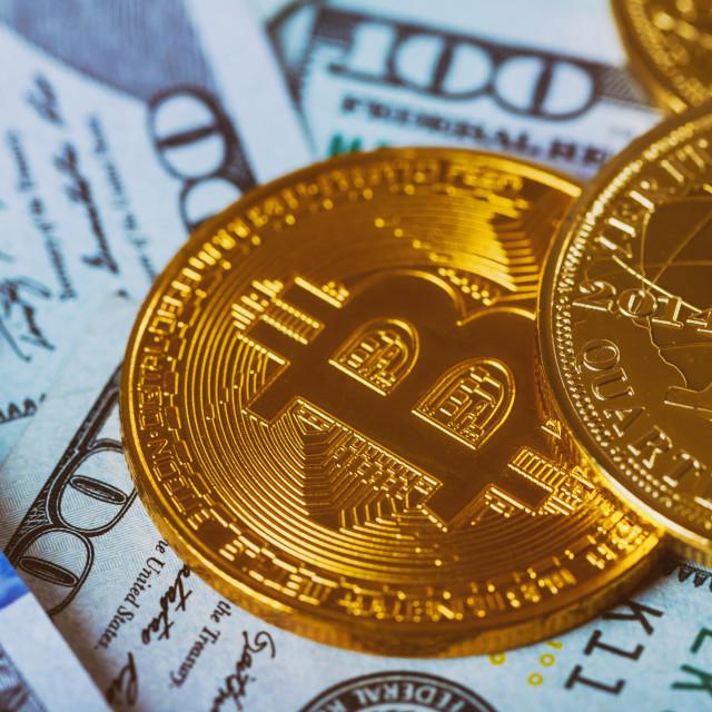 """Gold Bitcoin on hundred dollars bills. Bitcoin on us dollar bills electronic..."" stock image"