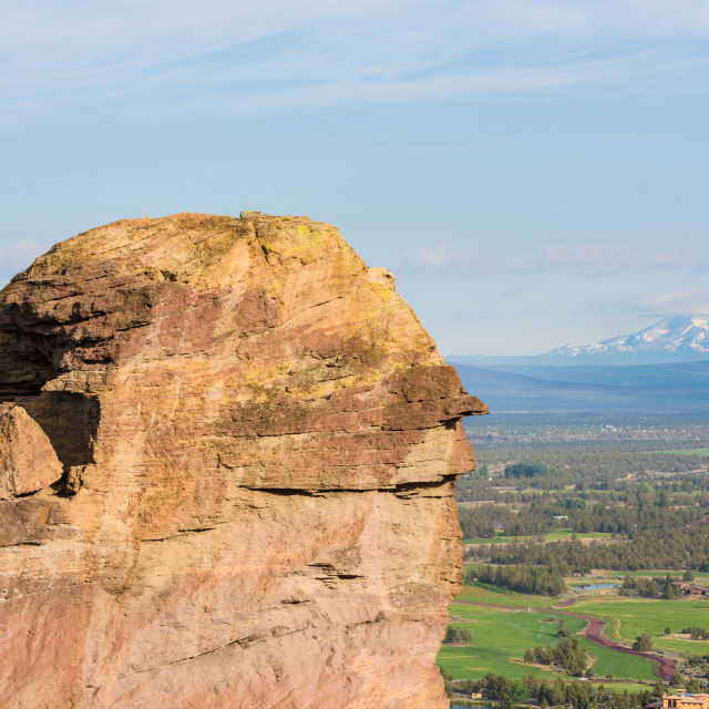 """""""Rock column used for climbing in Smith Rock State Park, and Mount Jefferson..."""" stock image"""