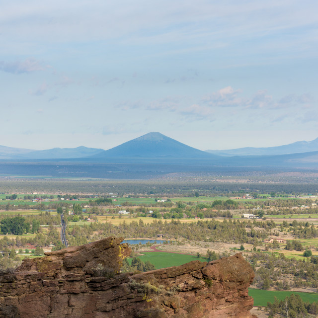 """Blac Butte volcano seen from Smith Rock trail, with pine trees and rocks in..."" stock image"