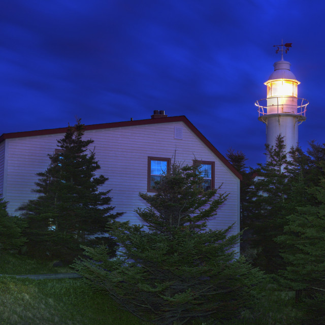 """""""Lobster Cove Head Lighthouse at night"""" stock image"""