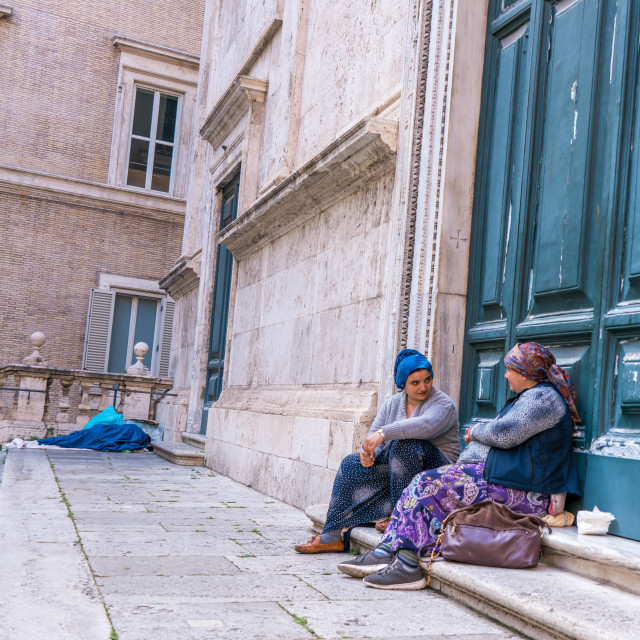 """Two women beggars on steps of church"" stock image"