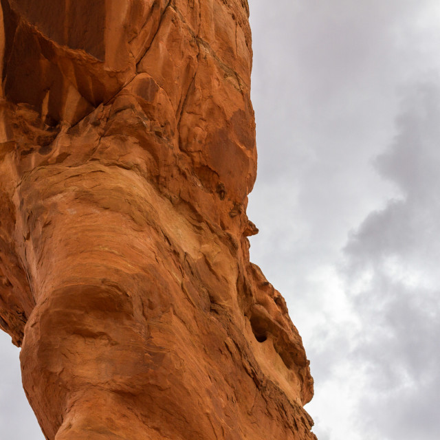 """Delicate Arch up close under a cloudy sky"" stock image"