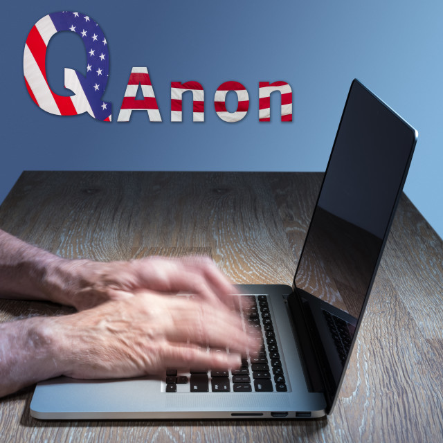 """""""Senior caucasian man types about Q Anon deep state conspiracy"""" stock image"""
