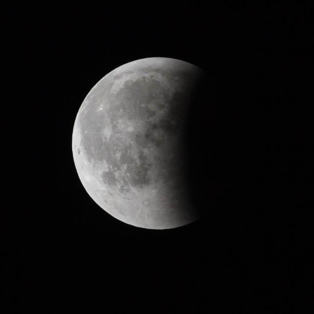 """""""Super Bloody Moon, full eclipse last phase against black sky background, one third of the Moon surface covered by Earth's shadow"""" stock image"""