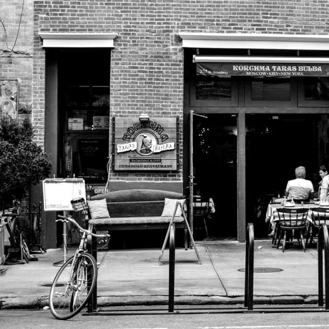 """Cafe and Bike Sitting"" stock image"