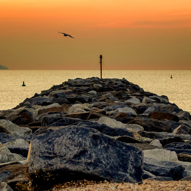 """Sovereign Harbour Arm, Eastbourne at Sunrise"" stock image"