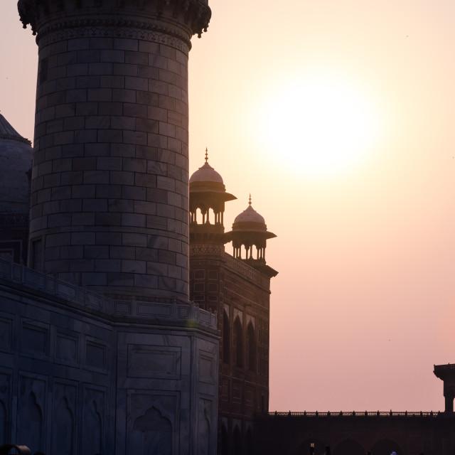 """Backlit closeup detail of the Taj Mahal towers and minarets, at sunrise, in..."" stock image"