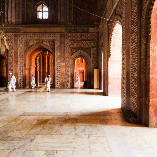 """""""AGRA, INDIA - 5 MAY 2015: Mosque workers sweeping the marble floor of the..."""" stock image"""