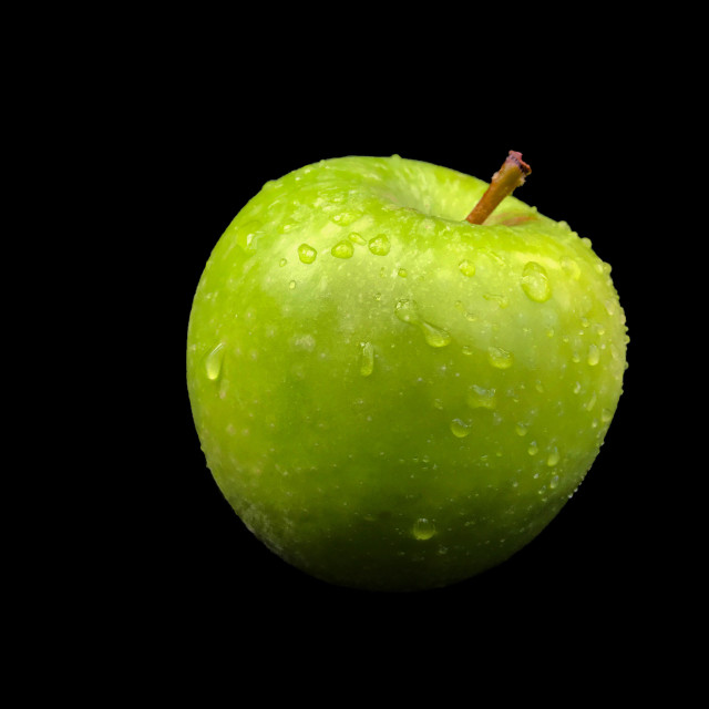 """Green apple against plain background"" stock image"