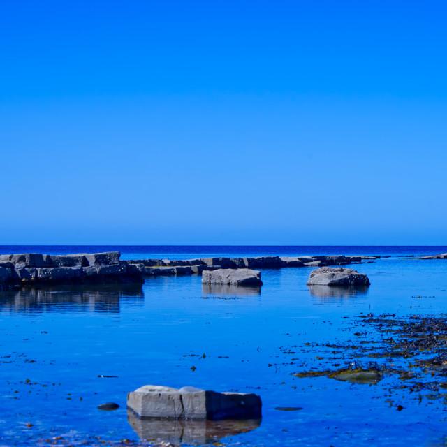 """Clear skies at Kimmeridge Bay"" stock image"