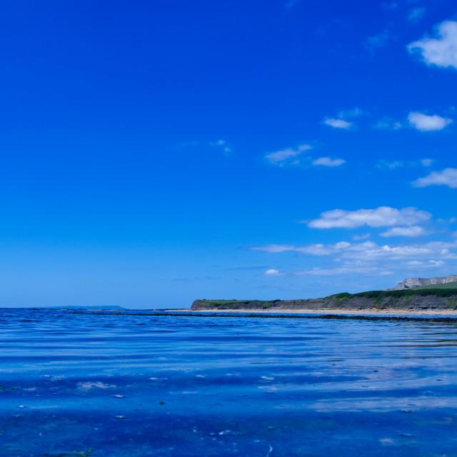 """Kimmeridge Bay view on a beautiful day"" stock image"