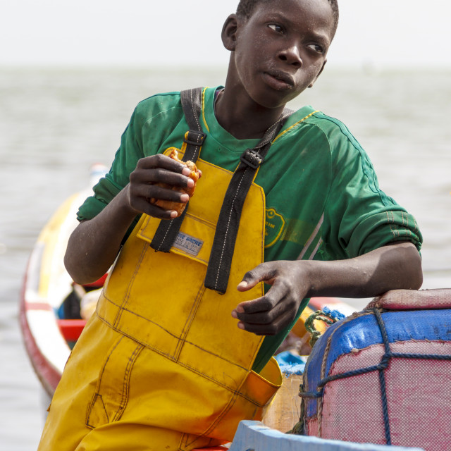 """Young fisherman eating snack"" stock image"