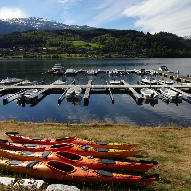 """Boats and kayaks in Ulvik, Norway"" stock image"