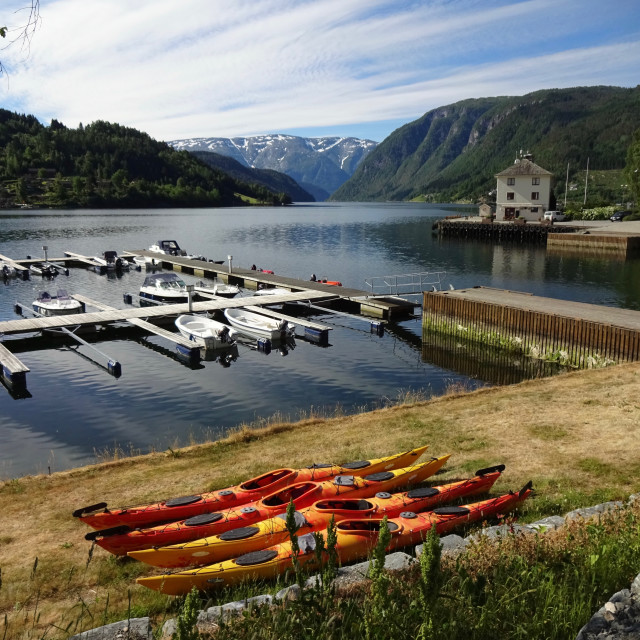 """Boats and kayaks in Ulvik fjord, Norway"" stock image"