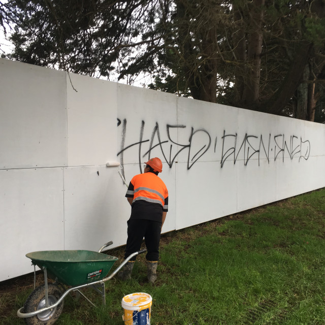 """""""Graffiti Removal Worker Auckland"""" stock image"""