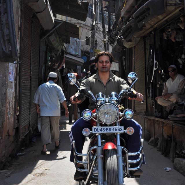 """Motorbike in Old Delhi side street"" stock image"
