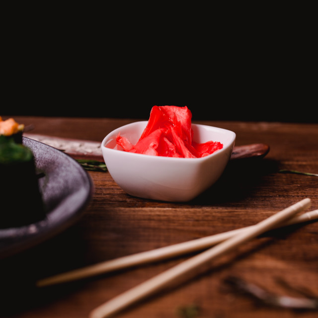 """Closeup pickled ginger, Sticks, Wasabi and soy sauce for sushi on brown wooden table background. Top view"" stock image"