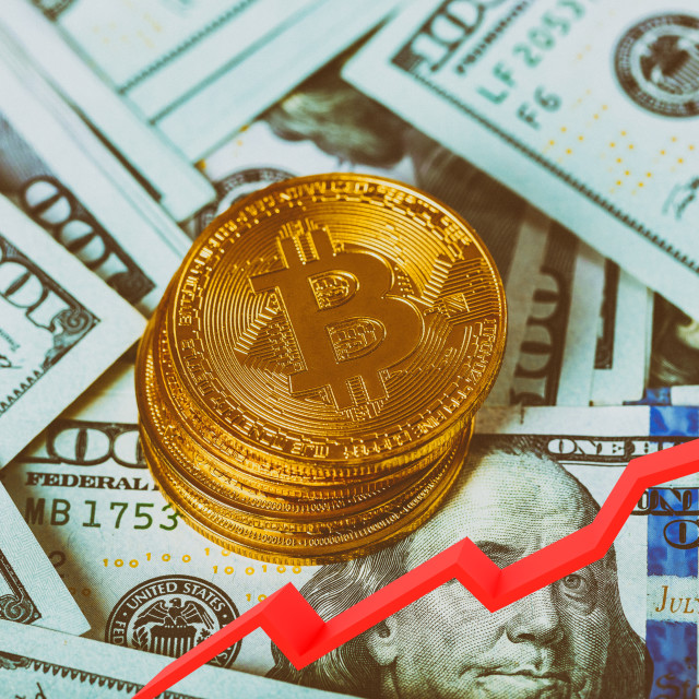 """""""Golden bitcoins on a us dollar and notebook. Bitcoin crypto currebcy on US..."""" stock image"""