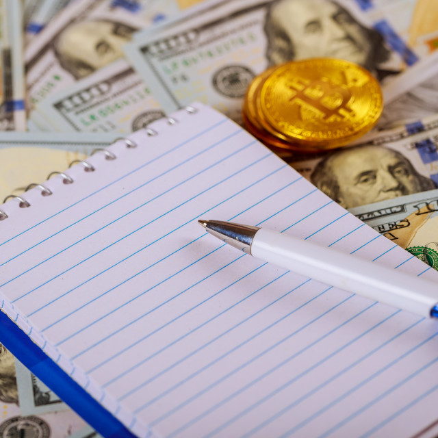 """""""Money banknote US dollar and coins put on wooden table with silver pen,..."""" stock image"""
