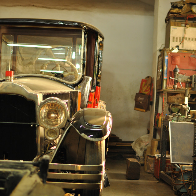 """Vintage car in an old workshop"" stock image"