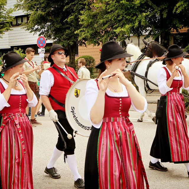 """Young women in Bavarian costume playing flutes"" stock image"