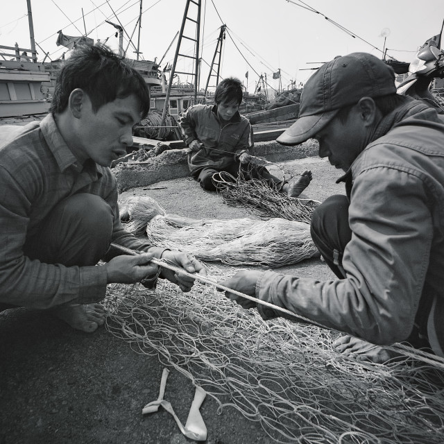 """Craftsmen Making Fish Nets in Da Nang, Film Photography"" stock image"