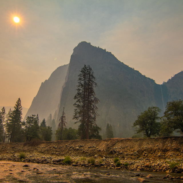 """Cathedral Peaks and Bridal Veil Falls shrouded in Wildfire Smoke"" stock image"