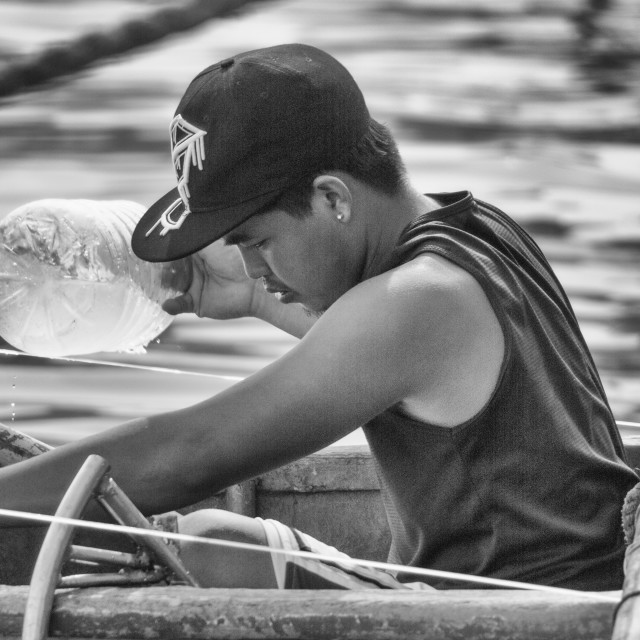 """Keeping Afloat Filipino"" stock image"