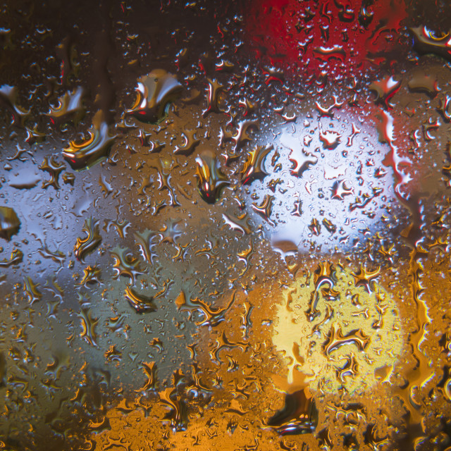 """Water drops on window with color background"" stock image"