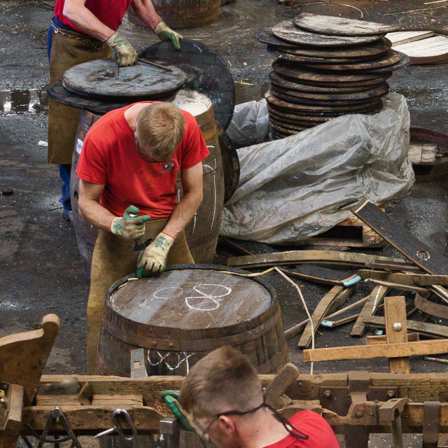 """Building Scotch Whisky barrels at the Speyside Cooperage"" stock image"